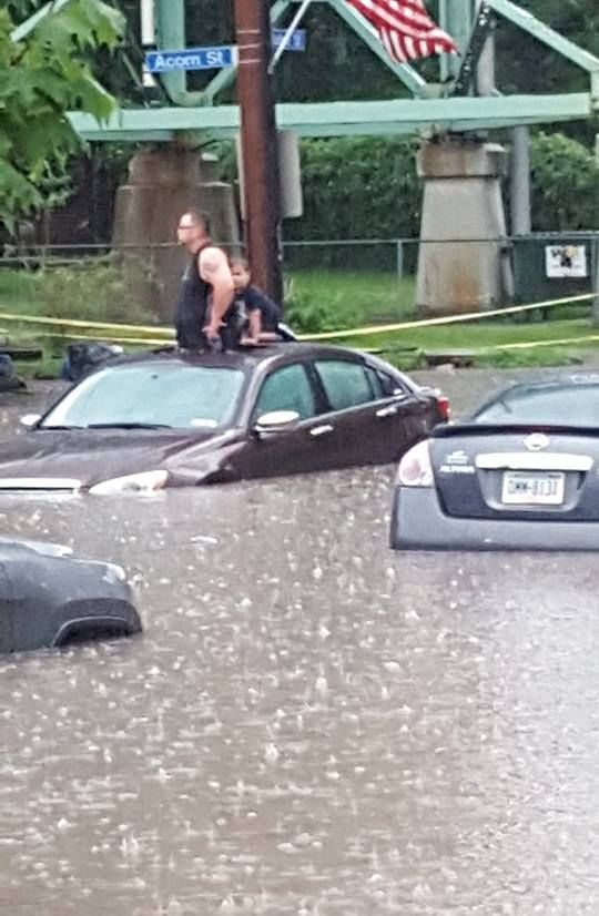 Father and son stranded in their car during flash flood in The Run, 28 Aug 2016 (photo by Justin Macey)