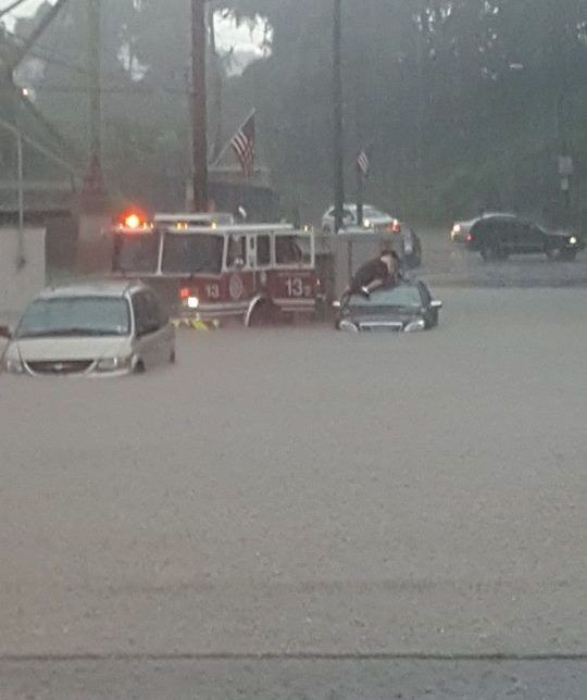 Firetruck arrives to rescue stranded father and son during flash flood in The Run, 28 Aug 2016 (photo by Justin Macey)