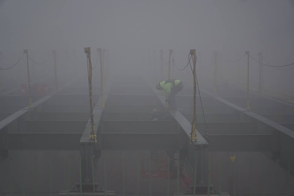 Worker on the Greenfield Bridge, in fog (photo by Pat Hassett)